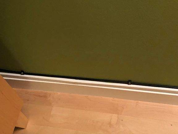 Ignored the cable raceway and drilled holes in newly painted walls